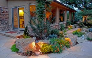 Mile-High-Landscaping-flagstone-patio-accent-boulder-steppers-landscape-lighting-naturalistic-planting